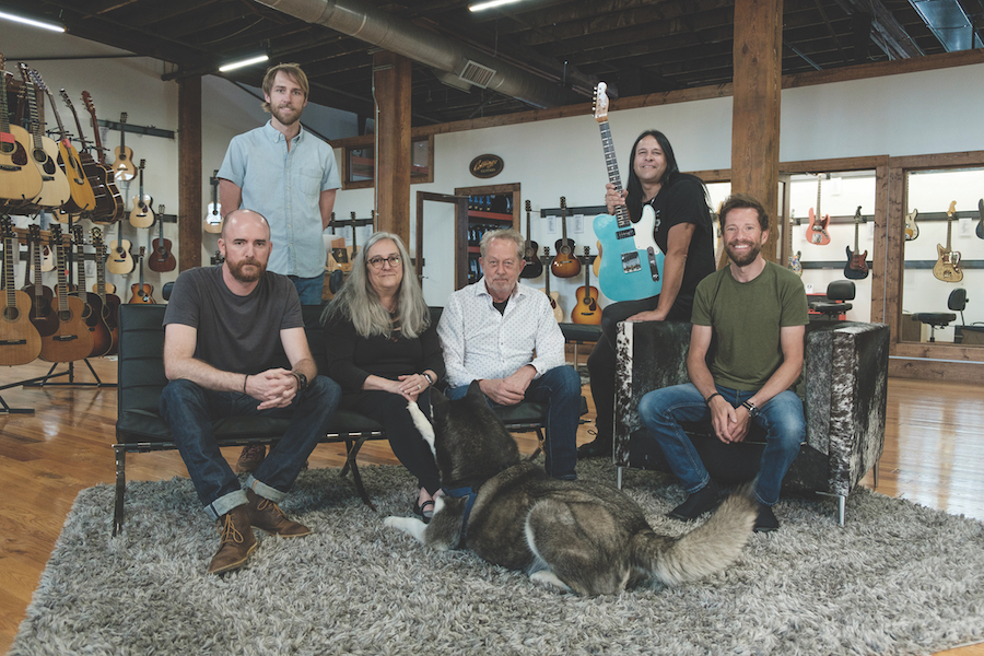 The Artisan Guitars team with camera-shy dog Woody.